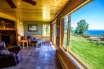 Large windows in the extended sitting room area brings in the great Lake Superior views.